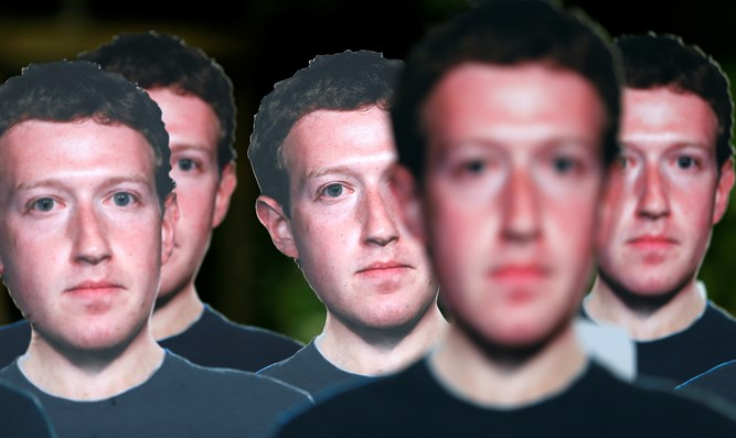 Cardboard cutouts depicting Facebook CEO Zuckerberg during demonstration