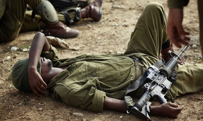 Soldier rests after grueling training at base near South Hevron Hill