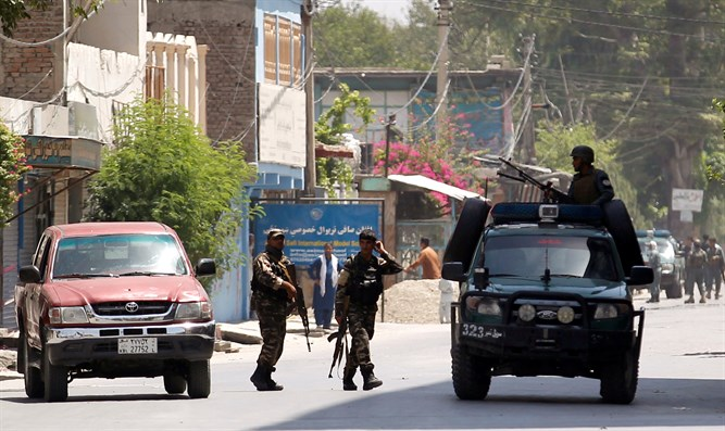 Afghan security forces arrive at area where explosions and gunshots heard