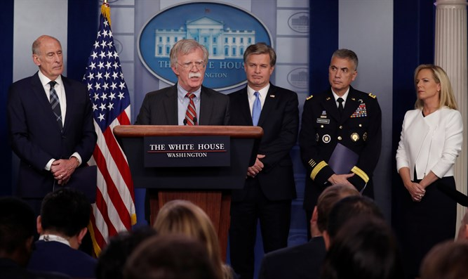 Bolton (podium) holds security briefing in White House press briefing room