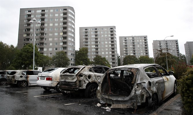 Burned cars at Frolunda Square in Gothenburg