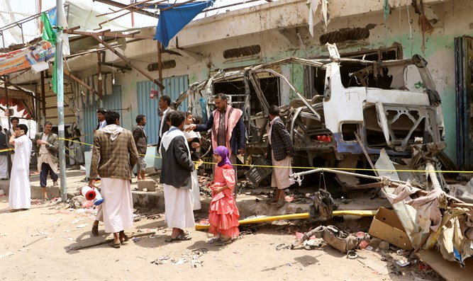 People view wreckage of school bus in Saudi Arabia's Saada province