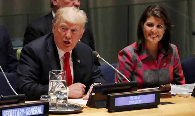 U.S. President Donald Trump speaks as U.N. Ambassador Nikki Haley looks on