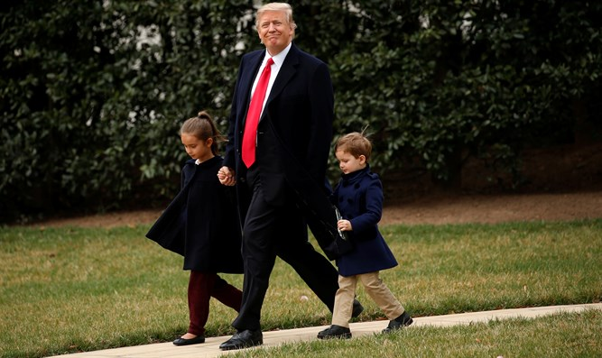 Donald Trump with grandchildren Arabella and Joseph Kushner
