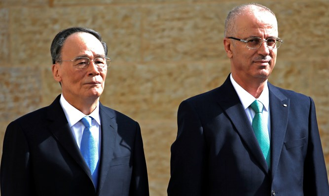 Wang Qishan and Rami Hamdallah
