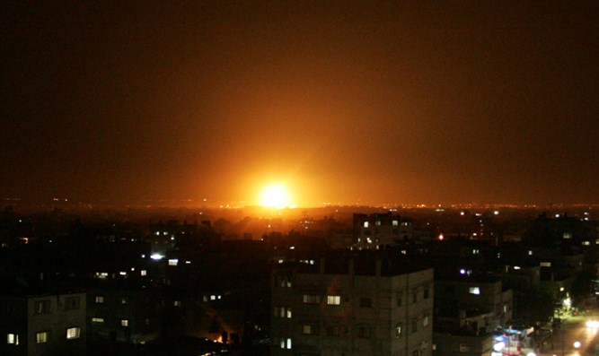 Explosion and smoke rise following an Israeli air strike in southern Gaza