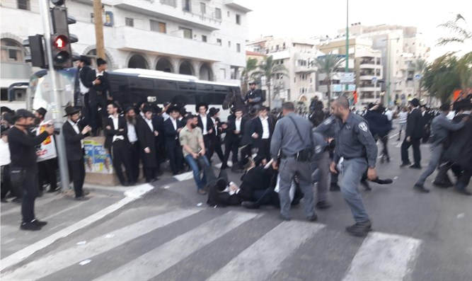 Police and haredi demonstrators clash in Bnei Brak