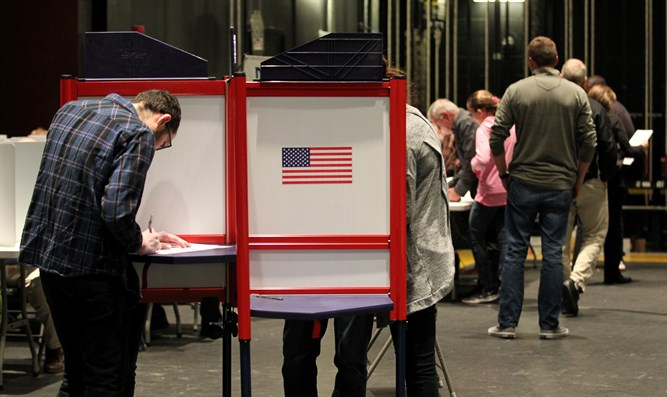 Voters fill in their ballots in the US midterm election