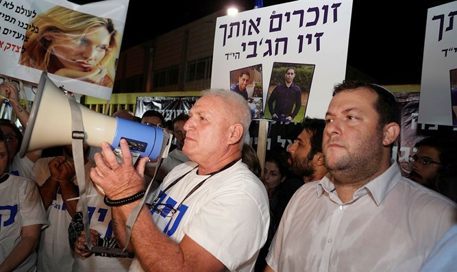 Rafi Levengrond during a memorial rally for his daughter