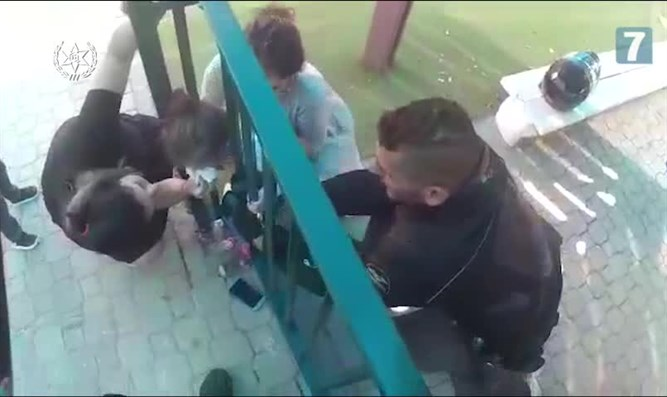 police rescue toddler with head stuck between bars