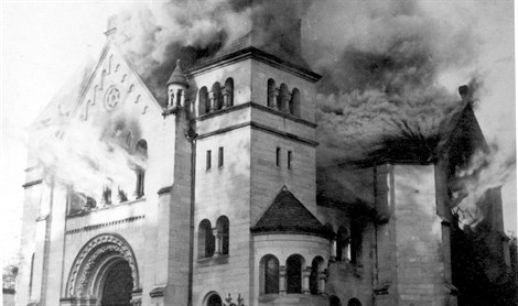 A synagogue burning after Kristallnacht