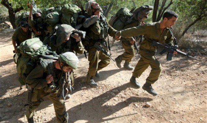 Soldiers carry stretcher in training.