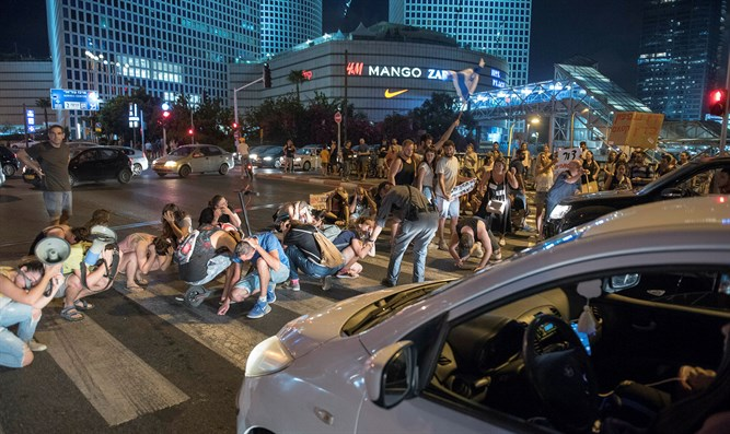Residents of southern Israel protest in Tel Aviv Thursday evening