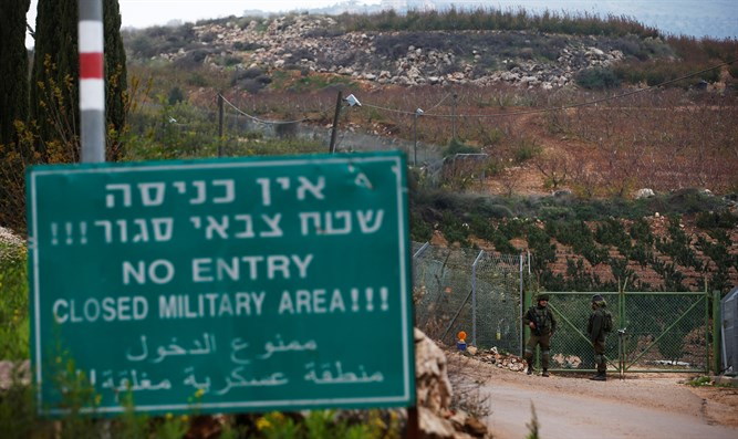 Israeli soldiers guard near border with Lebanon in town of Metulla