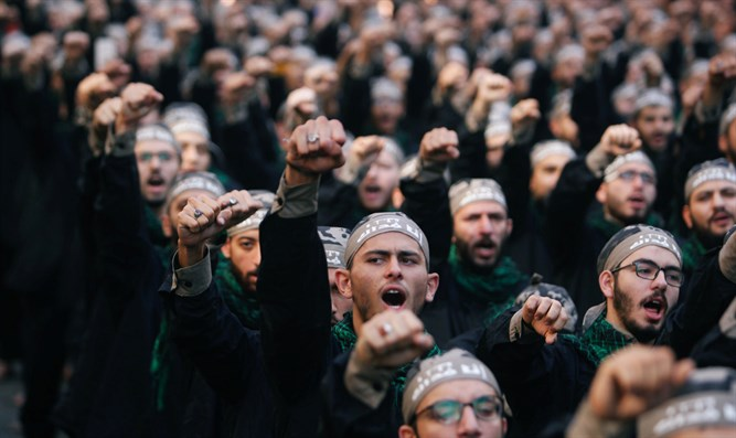Lebanon's Hezbollah supporters chant slogans during last day of Ashura in Beirut