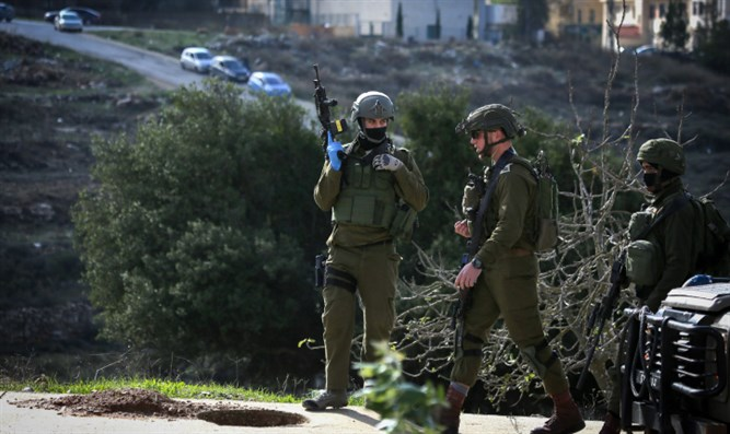 IDF soldiers searching for terrorists near Ramallah after Ofra attack