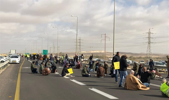 Protesters block road