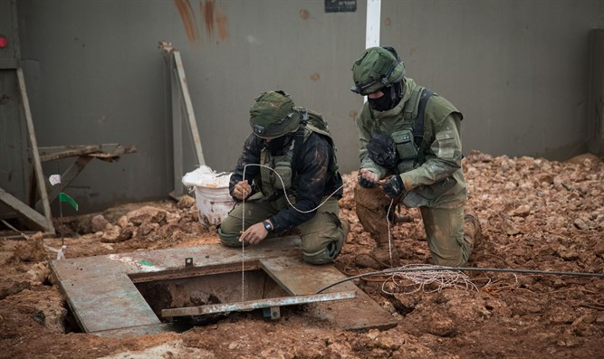 Israeli soldiers stand near tunnel crossing from Lebanon to Israel