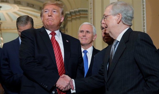 Trump shakes hands with Mitch McConnell