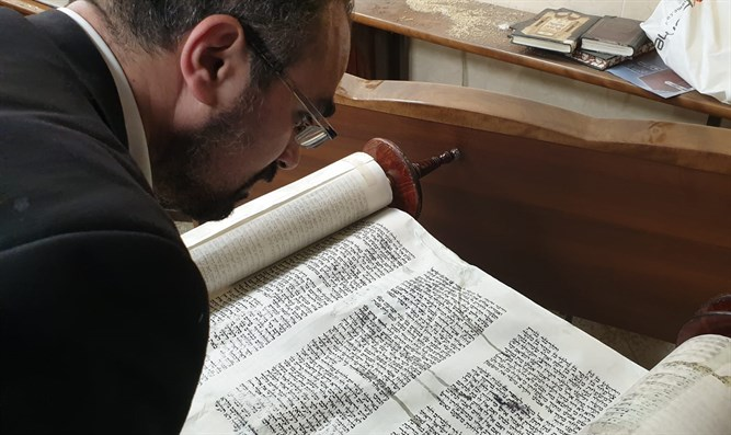 One of the Torah scrolls damaged in Siach Yisrael synagogue