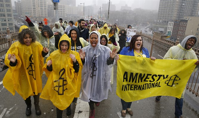 Amnesty International activists demonstrate in NY