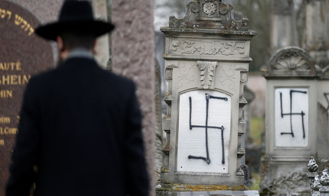 Rabbi of Strasbourg's Jewish community inspects vandalized cemetery