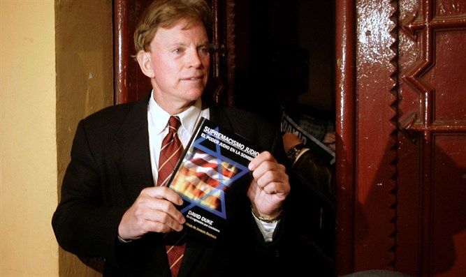 David Duke holds up Spanish translation of his book 'Jewish Supremacism'
