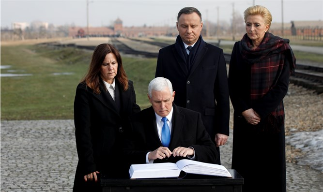 Pence signs visitors book at Auschwitz-Birkenau