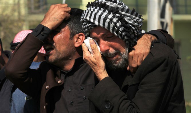 Relatives of victims killed in ferry accident mourn outside Mosul morgue