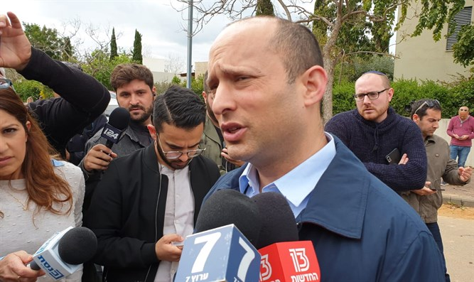 Bennett at scene of rocket attack in central Israel