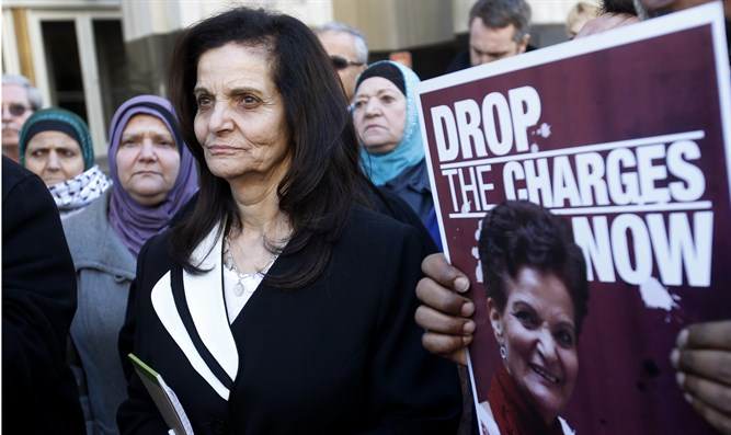 Rasmieh Yousef Odeh stands outside the federal courthouse after her sentencing