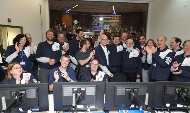 staff celebrates after successful space maneuver