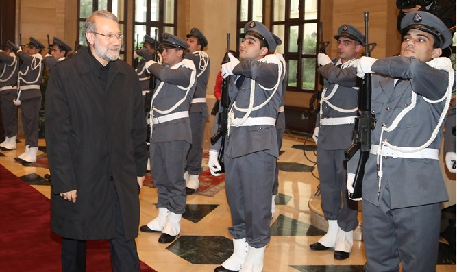 Iranian Parliament Speaker Larijani reviews honor guard