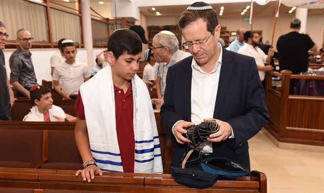 Yitzhak Herzog with one of the bar mitzvah boys