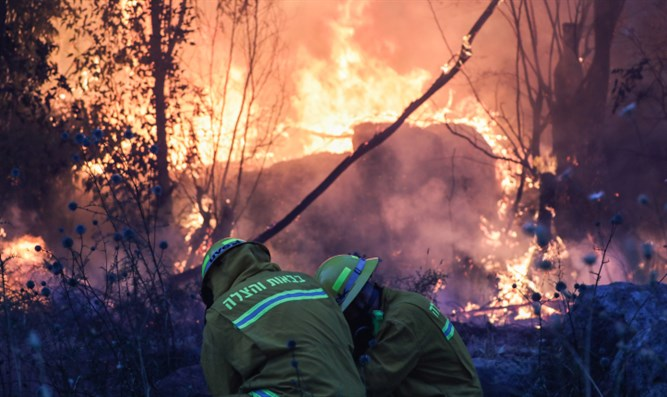 Firefighters battle blaze next to Kibbutz Harel