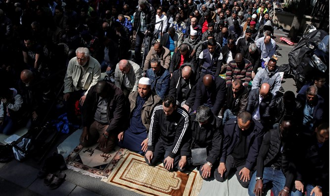 Muslims pray outside of city hall in the town of Clichy, near Paris.
