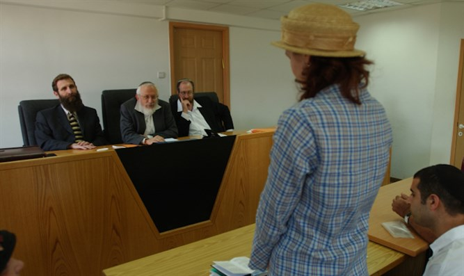 A woman converts to Judaism in front of a rabbinic court in Jerusalem