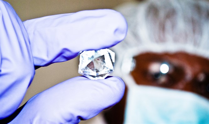Diamond specialist inspects diamond in rough