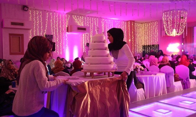 Serving cake during wedding party at Gaza City hotel