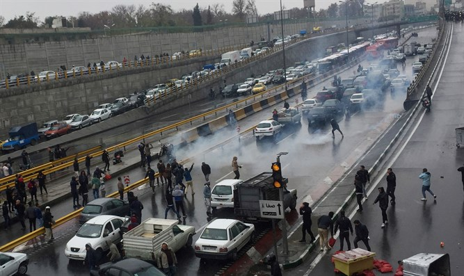 Protest against increased gas price on a highway in Tehran