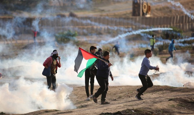 Protesters clash with Israeli soldiers during demonstration along Gaza border