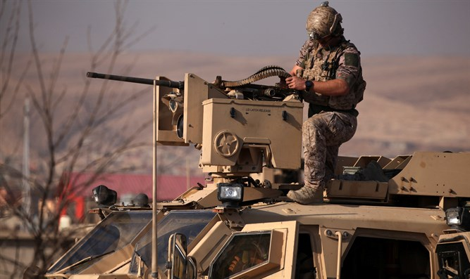 American soldier on armored vehicle in Iraq