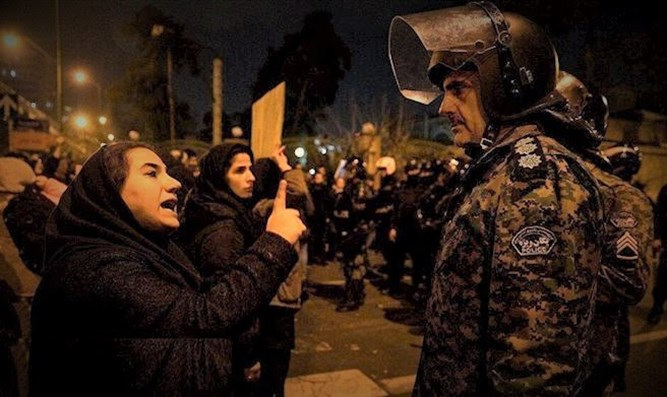 Women facing down soldiers in Tehran protest