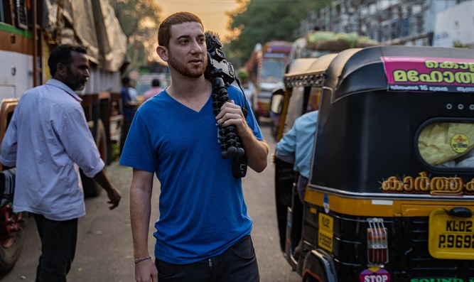 "Drew ""Binsky"" Goldberg, seen here in Kerala, India, makes a living traveling."