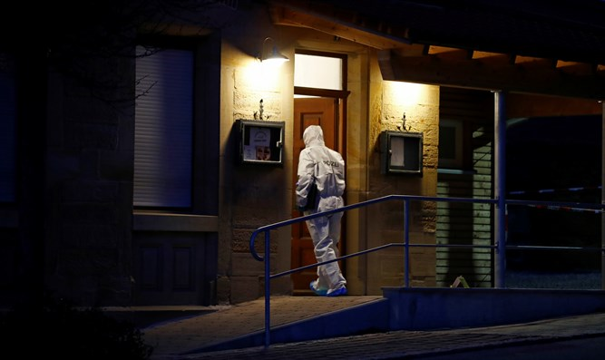 Forensic expert enters house in which shooting took place in Rot am See, Germany