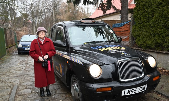 Anna Stupnicka-Bando gets set to enter one of the taxis for saviors of Jews