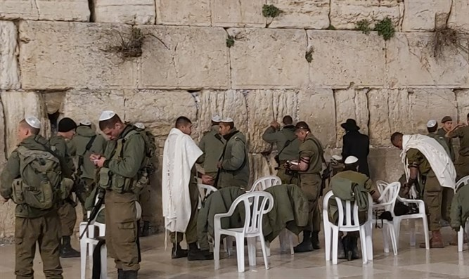 The soldiers praying at the Western Wall