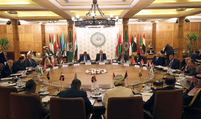 Permanent representatives of the Arab League take part in an emergency meeting