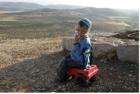 A child overlooks the community of Shvut Rach