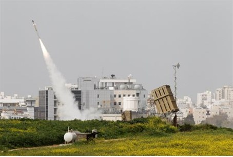 An Iron Dome launcher fires an interceptor ro